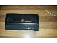 Black and gold new look purse
