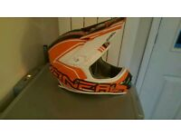 Brand new in box O'Neil motorcross helmet in size adults medium