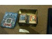 200 yugioh cards with tin