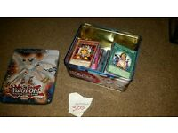 300 yugioh cards with mint condition tin