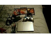 Silver slim PS2 with great games