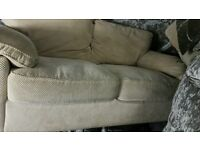 Cream material 2 seater couch and 2 chairs