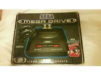 Boxed Sega mega drive 2 with 18 games and menacer gun