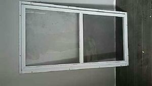 Storm windows and wooden frames with glass for sale