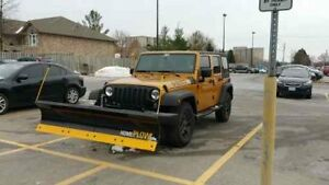 SNOW PLOW WITH HITCH FOR A JEEP WRANGLER