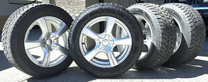 "Four Goodyear 18"" Tires and Wheels"