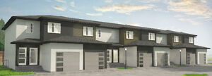 BRAND NEW 3 bdrm townhouse with on site Dog Park in Ste Anne