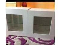 2 x Units in White with Glass fronts and shelf.