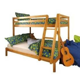 Triple sleeper pine wooden bed with mattresses in very good condition