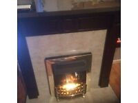 Mahogany fireplace with coal effect fire and hearth marble tiles
