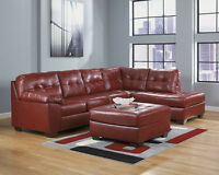 factory direct savings on this brand new leather sectional