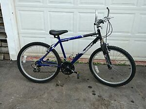Adult 18 speed bike with front fork suspension.