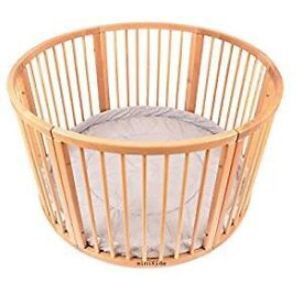 Lovely wooden circular playpen with padded cushion