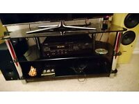 "black glass tv stand, upto 50"" tv good condition"