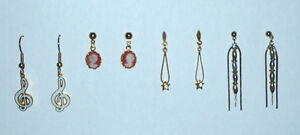 4 pair of Pierced Earrings ... As shown .. FREE alcohol pads ..