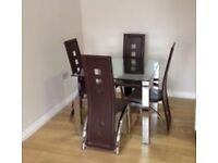 Set of 4 brown faux leather dining chairs