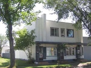 Triplex with 3 suites and oversized rented garage, zoned CNC