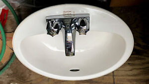 Bathroom ceramic sink with faucet