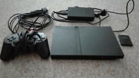 PLAYSTATION 2 SLIM, WITH AROUND 30 ODD GAMES PLUS 1 CONTROLLER AND MEMORY CARDS
