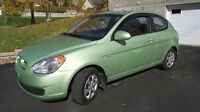 2008 Hyundai Accent Hatchback -- 5 speed manual.
