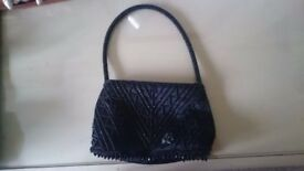 **Small black sequin handbag**