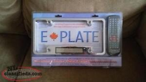Scrolling License Plate Frame ( E PLATE ) .....Brand new in seal