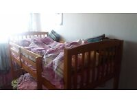 Solid pine Wooden Bunk Bed - Can be split into 2 Single beds - Excellent condition