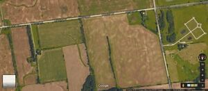 100 ACRES 5 MINUTES FROM CITY JUST OFF THE 401