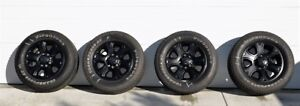 4 Dodge alloy rims LT285-60-20 Firestone tires (in Kelowna)