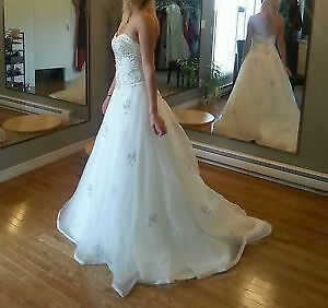 Wedding dresses (Tali Laurel )size 8 (which is pretty much a sma