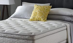New in plastic Luxury Queen Bed by Serta