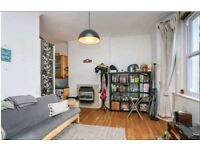 A bright and spacious one bedroom apartment located on the second floor of a period building