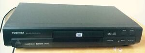TOSHIBA DVD player with remote control.