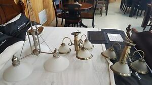 Slightly used chandelier light fixtures.