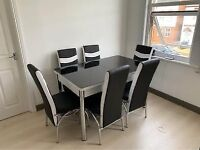brand new dining table and chairs available