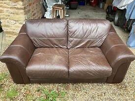 Free brown leather sofa for collection from Flecknoe