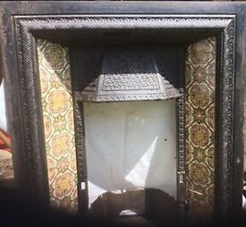 Original Victorian fire place beautiful tiles.