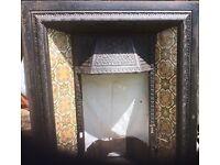 Original Victorian fire place beautiful tiles.