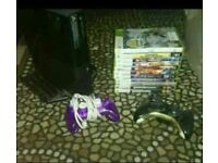 Xbox 360 E with 2x controllers and 10x games