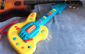 Child's Guitar with carry strap batteries included