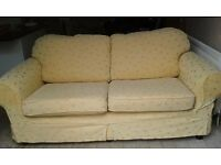 2 Seater Sofa with washable loose covers, Yellow looks better than the photograph !