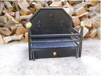 large very heavy cast iron open wood burning fire with solid brass finials