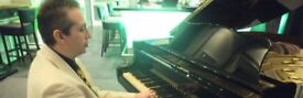 Pianist for weddings, events, parties. Reasonable rates. London/Surrey