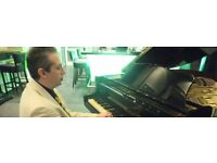Adult Piano Lessons - Fully qualified teacher.Classical, Jazz, Pop.Travels to S.London/City/Surrey