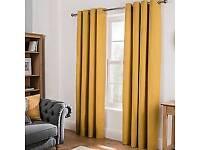 Eyelet yellow curtains