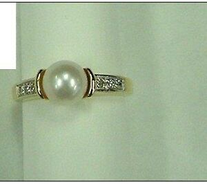 New, 14K Ring. 7.5mm Cultured pearl and 6 diamond Sz 8.5
