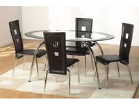 VERSIE ROUND GLASS DINING TABLE AND 4 LEATHER CHAIRS