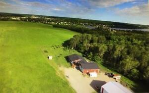 Rare Opportunity to own an acreage with Minnedosa town limits!