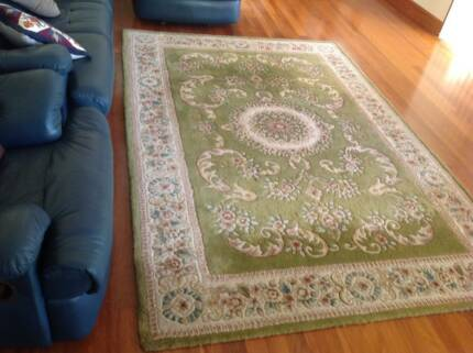 Two large identical woolen rugs