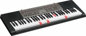 Casio light up Glow Keyboard. Keys light up, Red when touched.